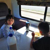 kids-having-breakfast-inside-motor-home-family-rv-caravan-food-travel-eating-motorhome-healthy_t20_lon2RB