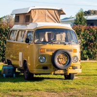 yellow-volkswagen-type-2-kombi-with-roof-top-tent-travel-and-tourism-in-australia_t20_nXrK4P